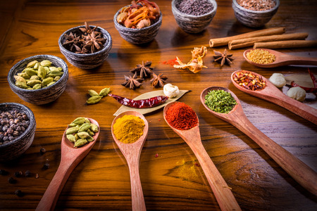 asian flavors: Asian spices of different flavors arranged in wooden spoons and bowls