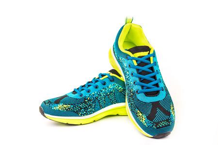 Ergonomic comfortable designer sport shoes in brigh colors over white background