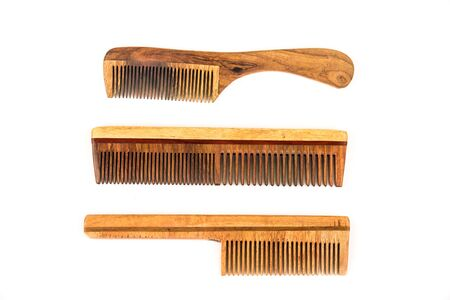 Classic wooden combs of different styles over white background Фото со стока