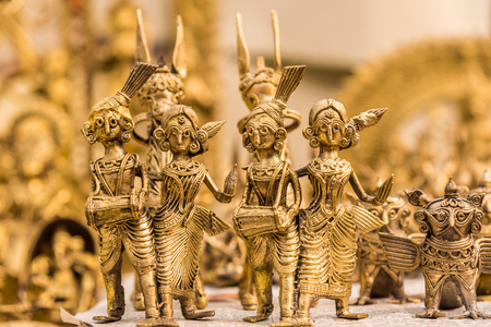 music band: Beautiful golden dolls made of brass of miniature folk musicians performing in a band of classical Indian music Stock Photo