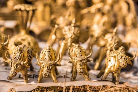 indian buffalo: Beautiful miniature golden charging bulls made of brass