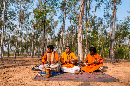indian fair: SHANTINIKETAN, INDIA - DECEMBER 22: An Indian traditional baul folk band performs during the annual Poush Mela fair on December 22, 2012 in Shantiniketan, West Bengal, India.