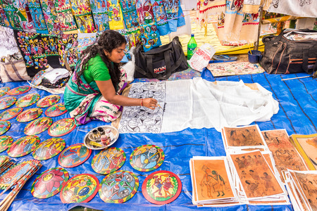 west bengal: SHANTINIKETAN, INDIA - DECEMBER 25: An Indian artisan paints on colorful handicraft items for sale during the annual Poush Mela fair 2015 on December 25, 2015 in Shantiniketan, West Bengal, India. Editorial