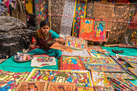 indian fair: SHANTINIKETAN, INDIA - DECEMBER 25: An Indian artisan paints on colorful handicraft items for sale during the annual Poush Mela fair 2015 on December 25, 2015 in Shantiniketan, West Bengal, India. Editorial