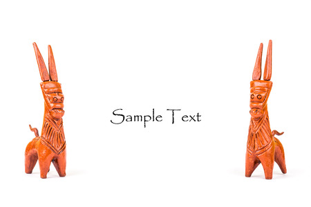 Beautiful pair of red clay horses from Bankura isolated over white with space for text.