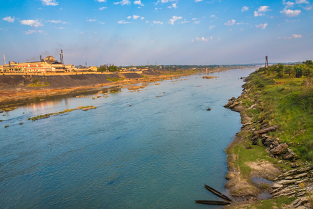 Beautiful Subarnarekha river flowing through Ghatsila with Hindustan Copper factory in the background.