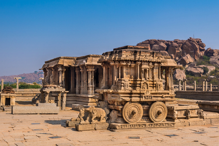 Famous stone chariot in Vittala temple well known for its exceptional architecture in Hampi, India. These ruins are from the Hindu Vijayanagara empire which existed in the 14th century. Stock Photo