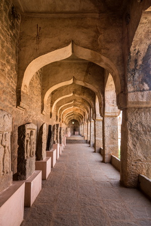 Beautiful arches inside the archaeological musium in Hampi containing ancient ruins of 14th Century Vijayanagara empire.