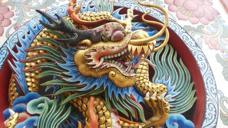 swagger: Hidden Dragon, swagger big dragon claws outstretched. With big eyes and big fangs and long-HT has crested. A mirror and a long tongue mouth wide variety of colors including red, green and blue scales interchangeably Editorial