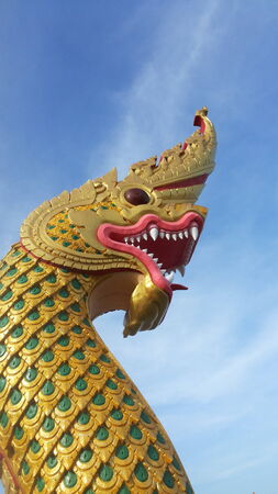 according: serpent statue golden scales