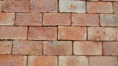 alternate: Wall made of red brick alternate look strong. A wall that provides stability. Red bricks are made from red clay. Sand and cement