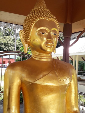 devotional: Golden Buddha Statue Stock Photo