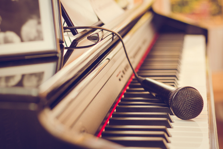 Piano keyboard and microphone