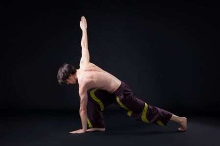 adaptable: Yoga workout in the studio on black background