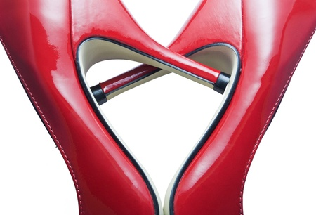 Detail of red shoes forming a heart photo