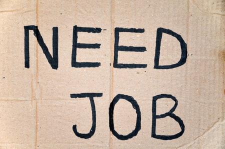 Need job written on cardboard Stock Photo - 10382640