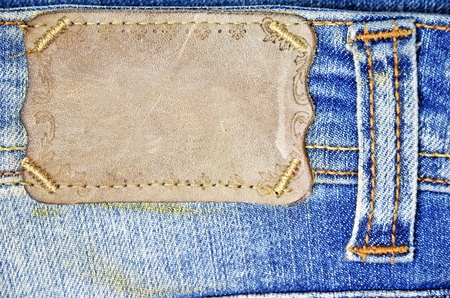 brown label on blue jeans