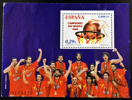 SPAIN - CIRCA 2006: A stamp printed in Spain showing Spanish basketball team the champion of the world, circa 2006  Stock Photo