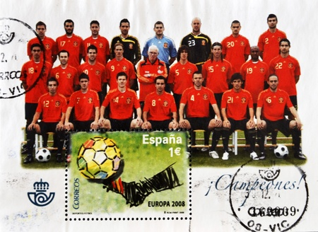 iniesta: SPAIN - CIRCA 2008: A stamp printed in Spain shows the Spanish football champions of Europe, circa 2008
