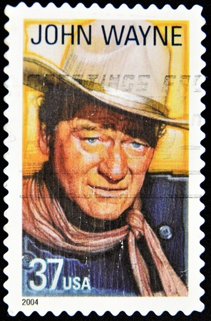 western united states: USA - CIRCA 2004: A stamp printed in United States of America shows famous american movies western actor John Wayne, circa 2004  Editorial