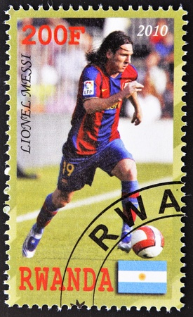 RWANDA - CIRCA 2010: A stamp printed in Rwanda shows showing lionel messi, best player football in the world, circa 2010