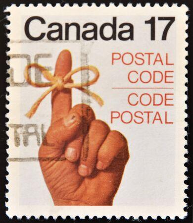 CANADA - CIRCA 1979: A stamp printed in Canada shows Ribbon Around Finger, circa 1979  photo