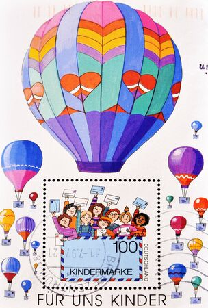 GERMANY - CIRCA 2002: A stamp printed in Germany shows picture of children with cards and balloons, circa 2002 Stock Photo - 10659030