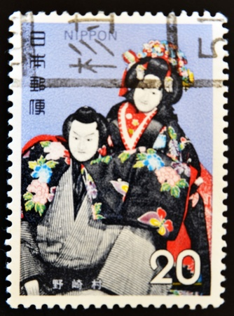 philately: JAPAN - CIRCA 2000: A stamp printed in Nippon shows a man and a woman dressed in typical Japanese, circa 2000
