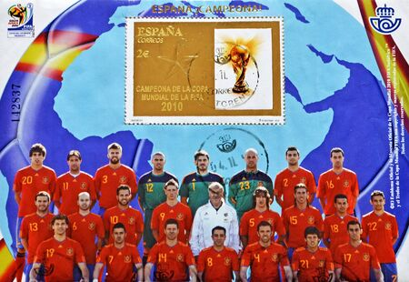 iniesta: SPAIN - CIRCA 2010: A stamp printed in the Spain, showing Spanish football World Cup Champion 2010 FIFA football, circa 2010