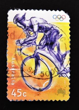 AUSTRALIA - CIRCA 2000: A stamp printed in Australia showing an Olympic cyclist, circa 2000