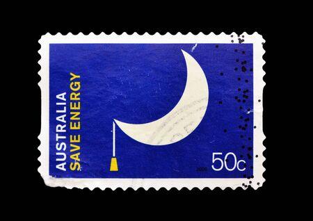 converted: AUSTRALIA - CIRCA 2008: A stamp printed in Australia showing a moon lamp converted to the concept of saving energy, circa 2008  Stock Photo
