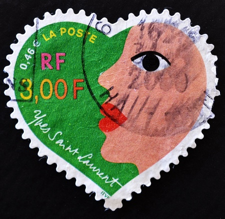 laurent: FRANCE - CIRCA 2000: A stamp printed in France that shows heart of Yves Saint Laurent with a woman