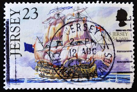 JERSEY - CIRCA 2004: A stamp printed in Jersey showing a sailing ship with the flag of United Kingdom, circa 2004  Stock Photo