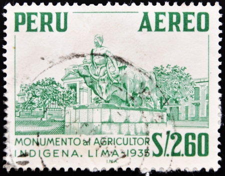 PERU - CIRCA 1935: A stamp printed in Peru shows monument to the indigenous farmer, circa 1935  Stock Photo - 10766487