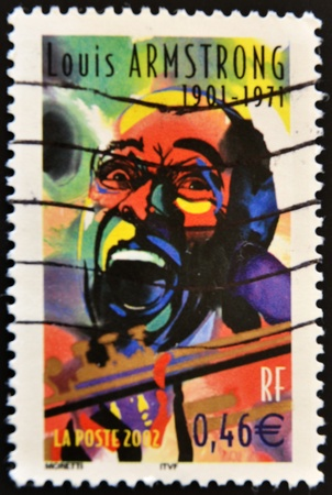 louis armstrong: FRANCE - CIRCA 2002: A stamp printed in France shows the famous musician Louis Armstrong, circa 2002