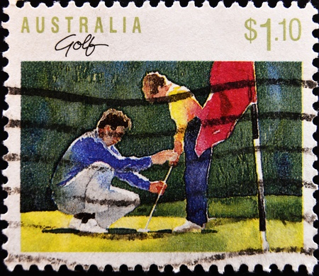 taught: AUSTRALIA - CIRCA 1990: a stamp printed in Australia shows young boy being taught golf circa 1990
