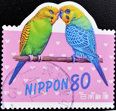 the two parrots: JAPAN - CIRCA 2000: A stamp printed in Japan shows two parrots, circa 2000