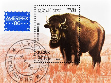 philately: LAOS - CIRCA 1986: A stamp printed in Lao Peoples Democratic Republic shows a bison, circa 1986 Stock Photo