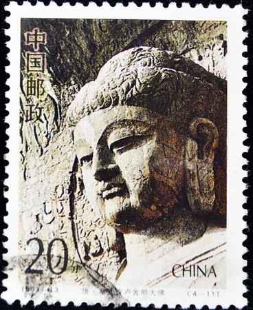 CHINA - CIRCA 1993: A stamp printed in China shows the statue of the Buddha's head, circa 1993  Stock Photo - 10766501