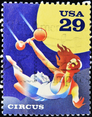 UNITED STATES OF AMERICA - CIRCA 1993: A stamp printed in USa shows a circus acrobat, circus 1993 Stock Photo - 10748633