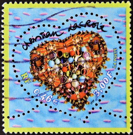 FRANCE - CIRCA 2000: A stamp printed in France that shows heart of Christian Lacroix with jewelry inside, circa 2000