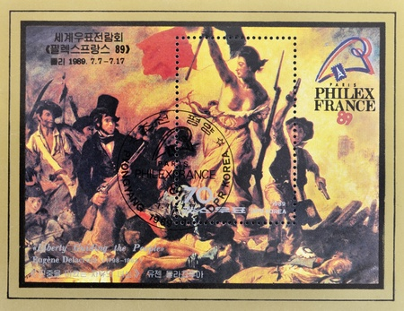 DPR KOREA - CIRCA 1989: A stamp printed in North Korea shows shows the Liberty Leading the People, painting by Eugene Delacroix, circa 1989  Editorial