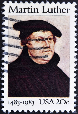 initiated: UNITED STATES OF AMERICA - CIRCA 1983: A stamp printed in USA shows image portrait Martin Luther was a German priest and professor of theology who initiated the Protestant Reformation, circa 1983.  Editorial