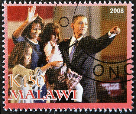 obama: MALAWI - CIRCA 2008: A stamp printed in Malawi shows the 44th President of United States of America, Barack Obama and your family, circa 2008