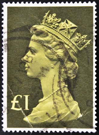 UNITED KINGDOM - CIRCA 1970: An English One Pound Used Postage Stamp showing Portrait of Queen Elizabeth 2nd, circa 1970  Stock Photo - 10741244