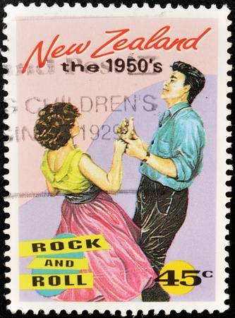 NEW ZEALAND - CIRCA 1994: A stamp printed in New Zealand shows a couple dancing a rock and roll from the 50, circa 1994  Stock Photo - 10741208