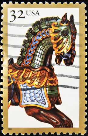carousel horse: UNITED STATES OF AMERICA - CIRCA 1995: A stamp printed in the USA shows image of a carousel horse, circa 1995 Stock Photo