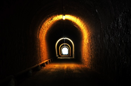 passageway: tunnel illuminated with light at the end