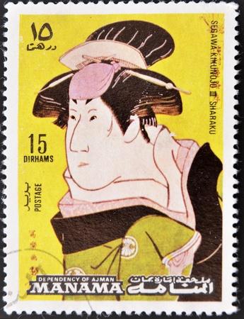 ajman: AJMAN - CIRCA 1980: A stamp printed in Ajman shows Sharaku drawing, circa 1980