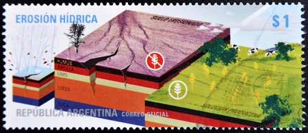 consequences: ARGENTINA - CIRCA 2009: A stamp printed in Argentina shows drawing the consequences of water erosion, circa 2009  Stock Photo
